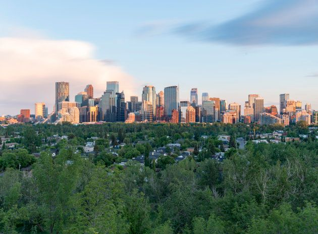Long exposure of Calgary downtown on a summer afternoon with green community in the
