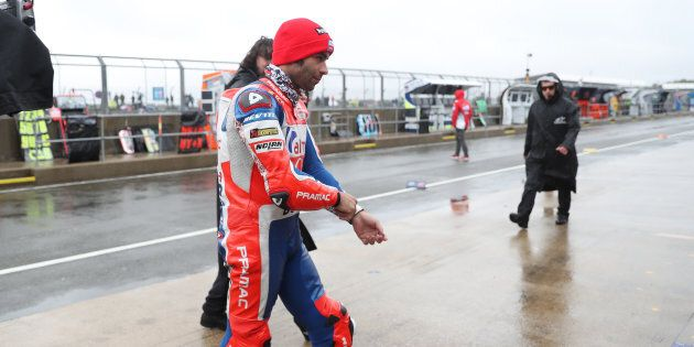 Danilo Petrucci in the pitlane as the GoPro British Grand Prix MotoGP is delayed at Silverstone, Towcester....