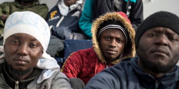 Migrants aboard the Sea-Eye rescue ship, in the Mediterranean Sea, Tuesday, Jan. 8, 2018. Two German...