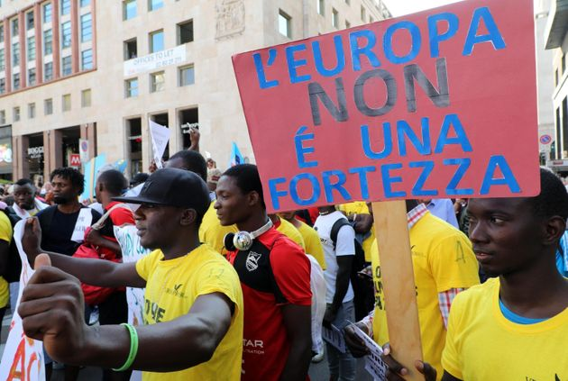 People hold a sign reading ''Europe is not a fortress'' as they take part in the demonstration 'Europe...