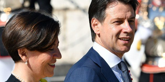 Italys Prime Minister Giuseppe Conte (R) and Italys Defence Minister Elisabetta Trenta (L) (Photo by...