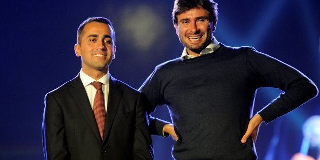 5-Star movement Luigi Di Maio (L) and Alessandro Di Battista are seen on stage during the final rally...