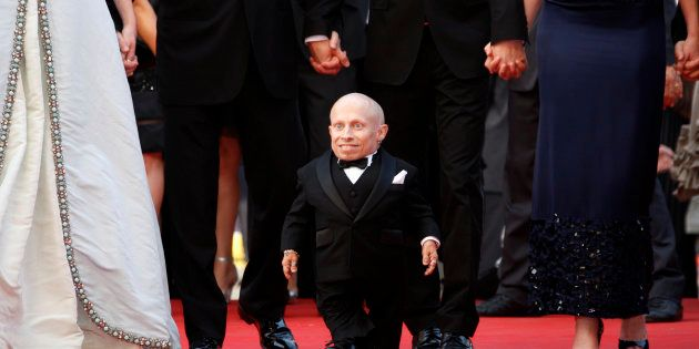 Cast member Verne Troyer arrives for the screening of the