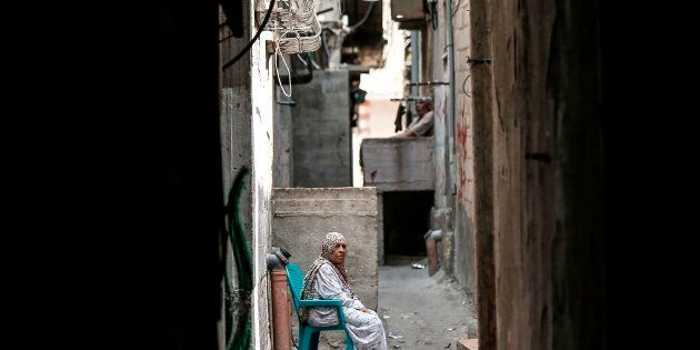 A Palestinian refugee sits in a street of the Al-Shati refugee camp, in Gaza City on September 1,