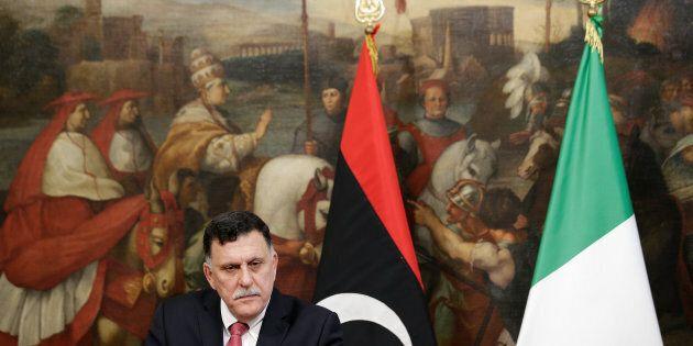 Libyan Prime Minister Fayez al-Sarraj attends a news conference with his Italian counterpart Paolo Gentiloni...