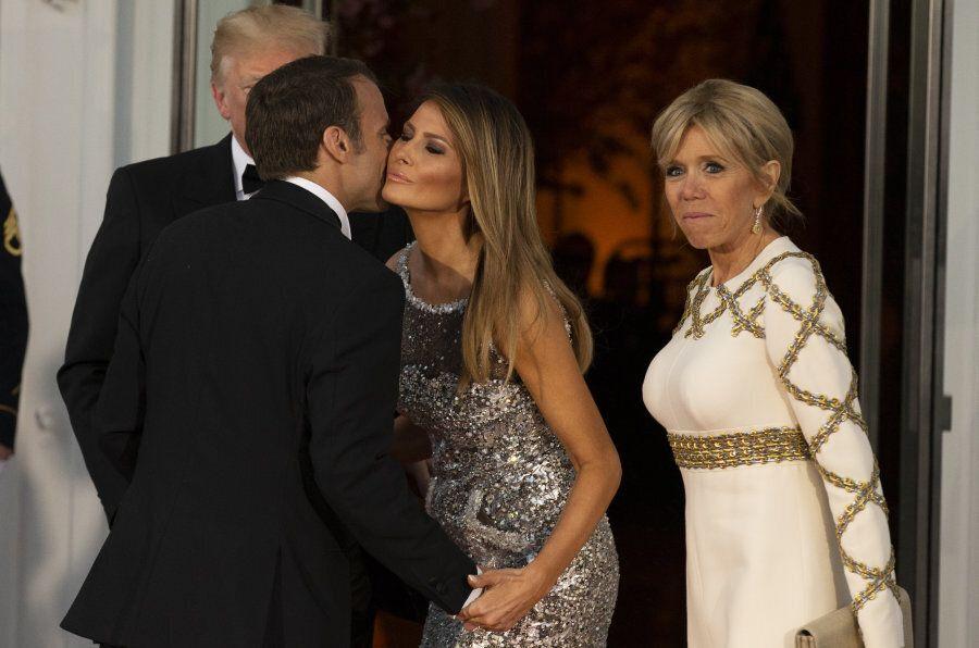 U.S. President Donald Trump, left, and U.S. First Lady Melania Trump, second right, greet Emmanuel Macron,...