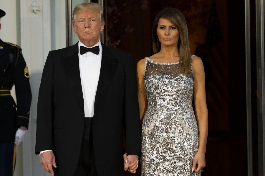 U.S. President Donald Trump, left, and U.S. First Lady Melania Trump arrive to greet Emmanuel Macron,...