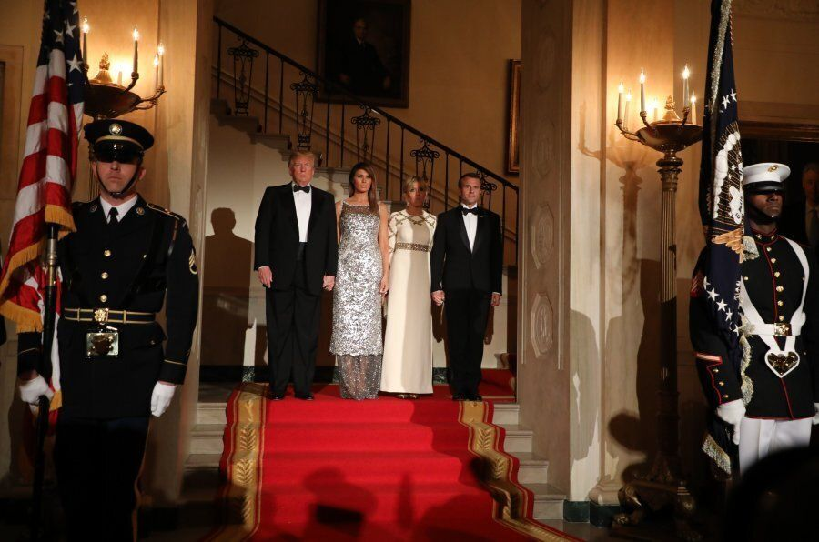US President Donald Trump and First Lady Melania Trump stand with French President Emmanuel Macron and...