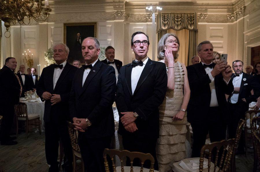 WASHINGTON, DC - APRIL 24: Treasury Secretary Steve Mnuchin stands with others before President Donald...