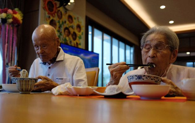 World's oldest living married couple Masao Matsumoto (L) and Miyako Matsumoto eat lunches at a nursing...