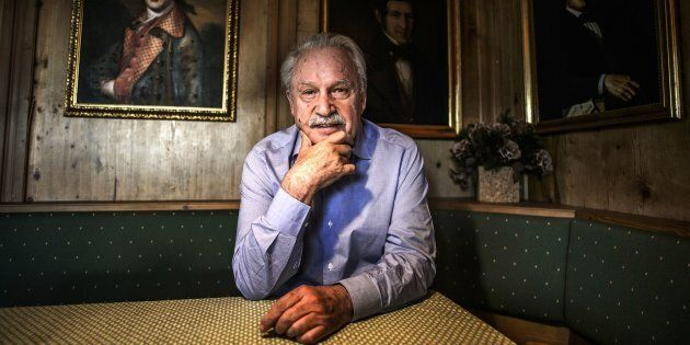 Music composer, DJ and record producer Giorgio Moroder poses next to the portraits of his ancestors in...