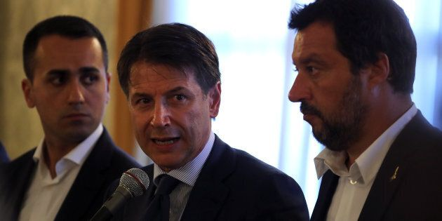 Italian Prime Minister Giuseppe Conte speaks as he is flanked by Interior Minister Matteo Salvini and...
