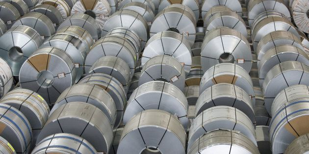 Rolls of steel sit in storage ahead of shipping from the Salzgitter AG plant in Salzgitter, Germany,...