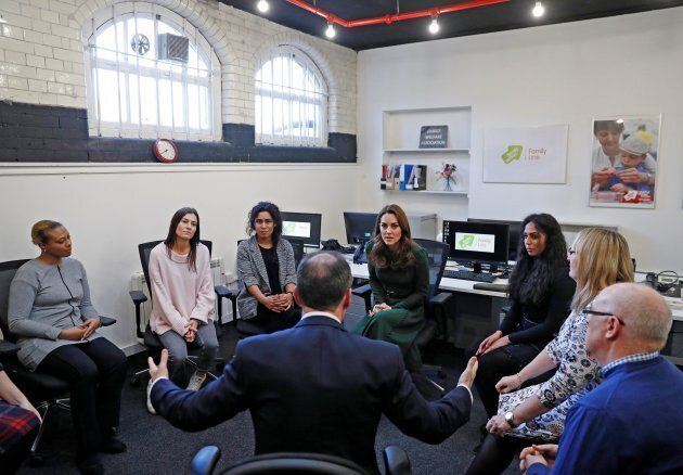 Britain's Catherine, Duchess of Cambridge (centre R) sits with counsellors during a visit to Family Action...