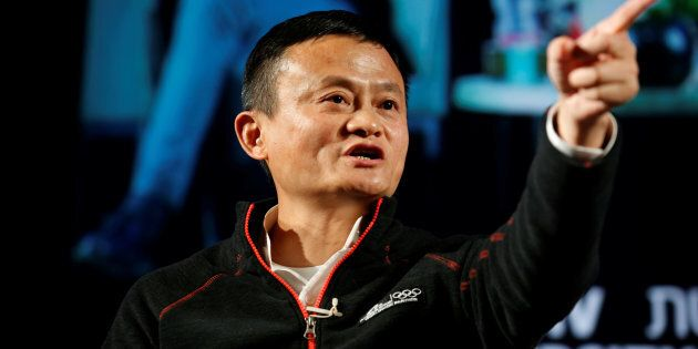 Jack Ma, founder of Chinese e-commerce giant Alibaba, speaks with students during an event at the Tel...