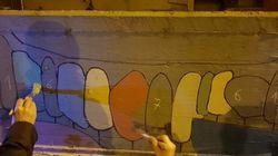 Un murales di cento metri in una notte. Bello come le belle storie che vanno oggi