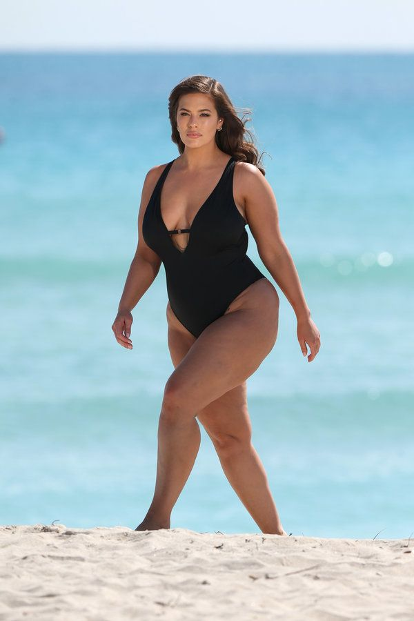 100349, EXCLUSIVE: Model Ashley Graham radiates body confidence as she poses in a sexy plunging black...