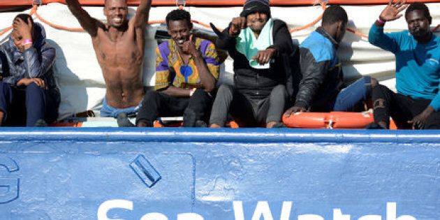FILE PHOTO: Migrants react as they rest on board the Sea Watch 3 off the coast of Siracusa, Italy, January...