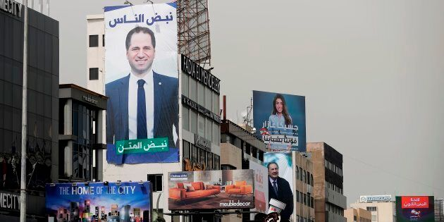 Portraits of candidates running in Lebanon's upcoming legislative elections, including Christian MP Sami...