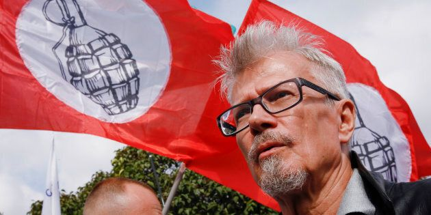 Eduard Limonov (R), the leader of The Other Russia party, attends a rally in Moscow August 4, 2013. The...