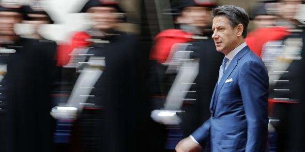 Italian Premier Giuseppe Conte walks past a honor guard prior to his meeting with Ethiopian Prime Minister...