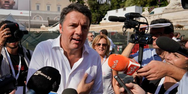 Former Italian Premier Matteo Renzi is surrounded by reporters as he attends a Democratic Party rally...