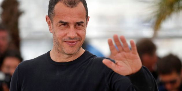 Director Matteo Garrone gestures as he poses during a photocall for the