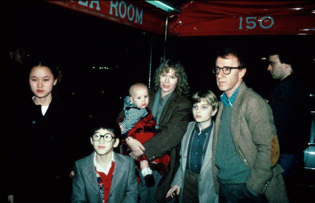 Actor/director Woody Allen (2R) and actress Mia Farrow (C, holding her daughter Dylan) w. her children...