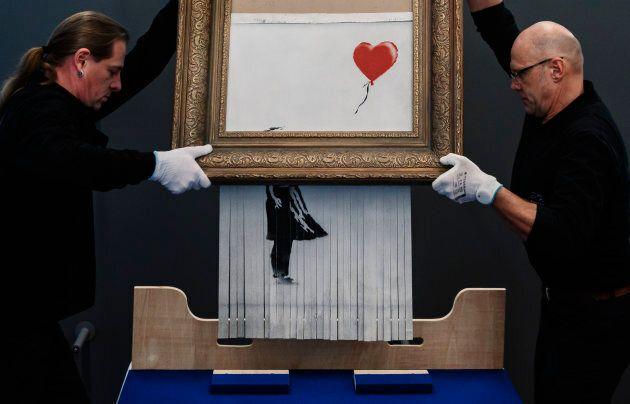 Il quadro autodistrutto di Bansky esposto in Germania per un