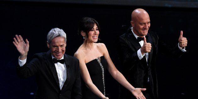 SANREMO, ITALY - FEBRUARY 05: Hosts Claudio Baglioni, Virginia Raffaele and Claudio Bisio on stage during...