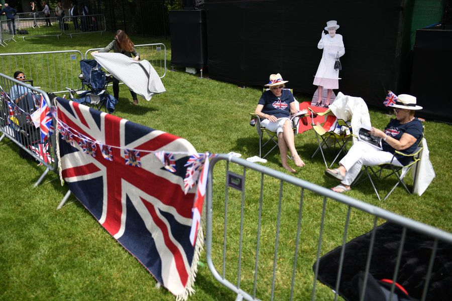 WINDSOR, ENGLAND - MAY 18: A cardboard cut-out of Britain's Queen Elizabeth II is seen as royal fans...