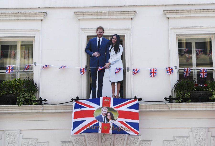 WINDSOR, ENGLAND - MAY 18: A cardboard cut-out of Prince Harry and Meghan Markle is displayed outside...