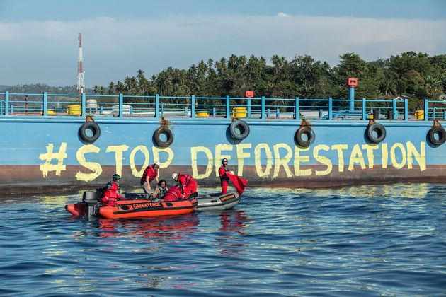 Greenpeace activist paint the body of ship using water based paint reads