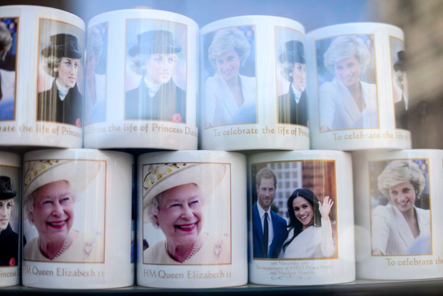 Souvenirs featuring Britain's Prince Harry and his fiance US actress Meghan Markle in a gift shop in...