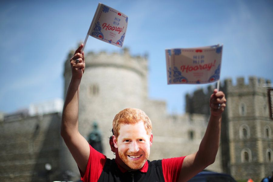 A person wear a Prince Harry mask outside Windsor Castle a day ahead of Prince Harry's and Meghan's Markle's...