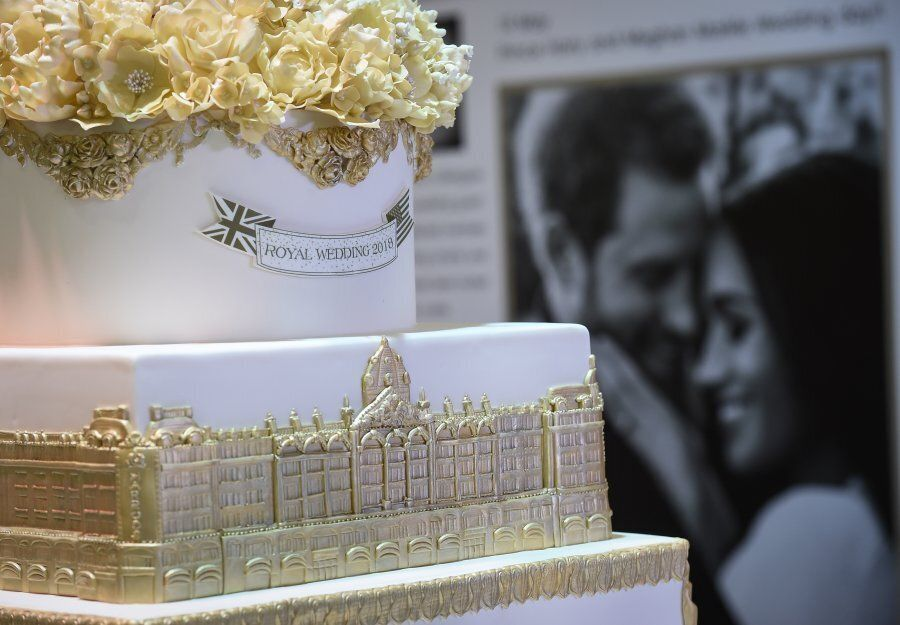 A wedding cake and portraits are displayed during the launch of an exhibition commemorating the royal...