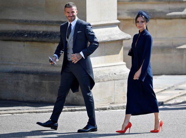 Former England footballer David Beckham (L) and fashion designer Victoria Beckham arrive for the wedding...