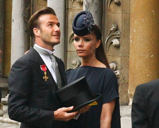 Soccer star David Beckham and his wife Victoria arrive at Westminster Abbey before the wedding of Britain's...