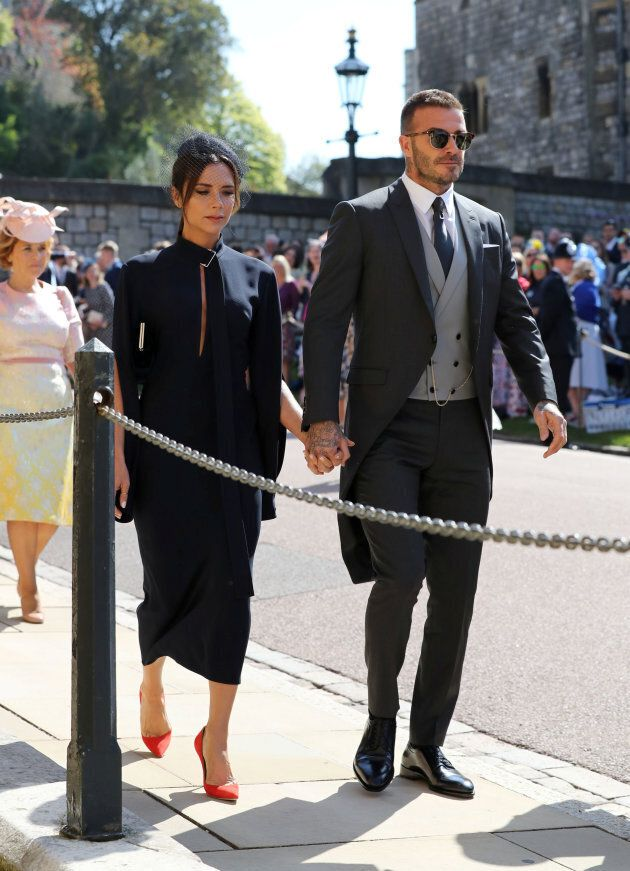 David Beckham and Victoria Beckham arrive at St George's Chapel at Windsor Castle for the wedding of...