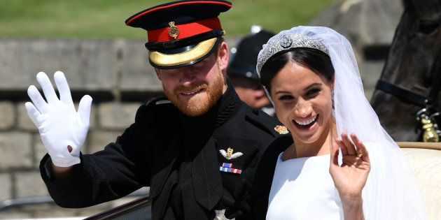 Britain's Prince Harry, Duke of Sussex and his wife Meghan, Duchess of Sussex wave from the Ascot Landau...