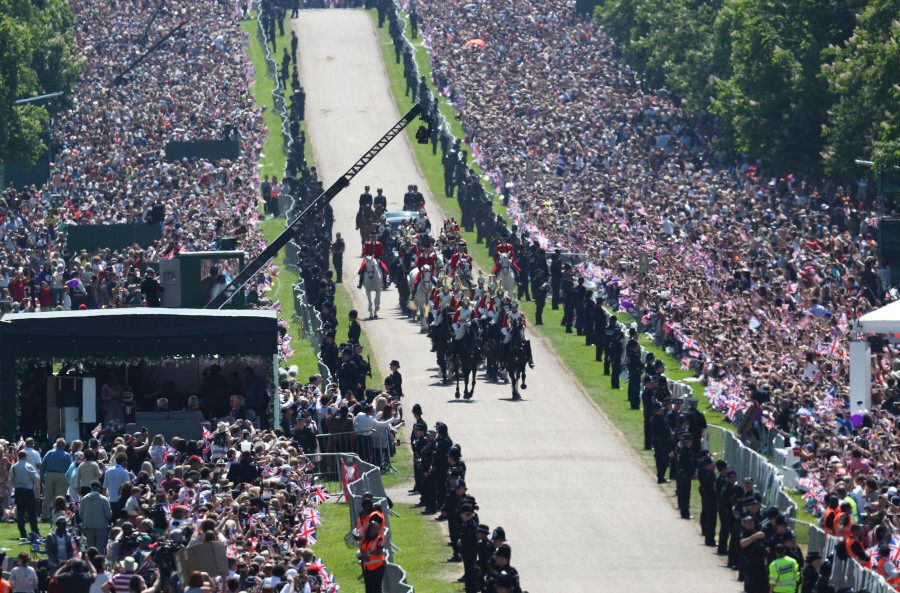 Prince Harry and Meghan Markle ride in an Ascot Landau along the Long Walk after their wedding ceremony...