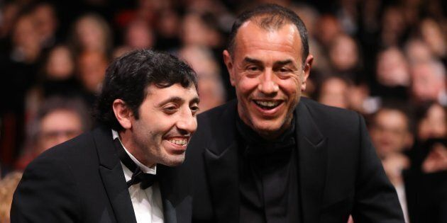 Italian actor Marcello Fonte (L) celebrates with Italian director Matteo Garrone after he was awarded...