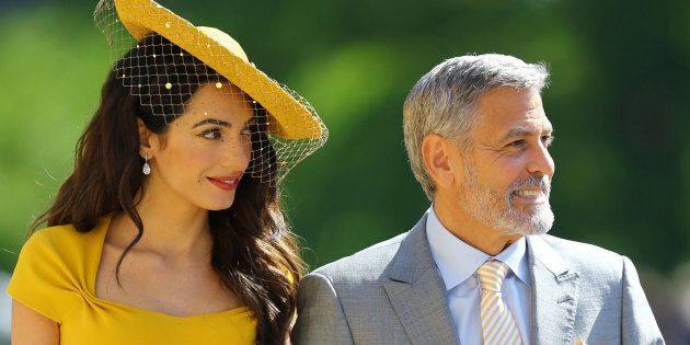 WINDSOR, UNITED KINGDOM - MAY 19: Amal Clooney and George Clooney arrive at St George's Chapel at Windsor...