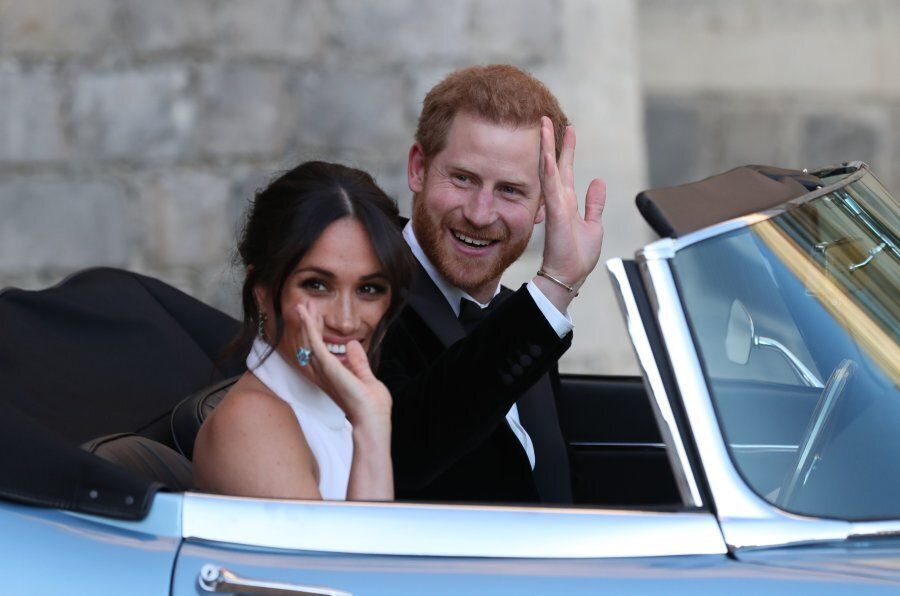 Britain's Prince Harry, Duke of Sussex, (R) and Meghan Markle, Duchess of Sussex, (L) leave Windsor Castle...