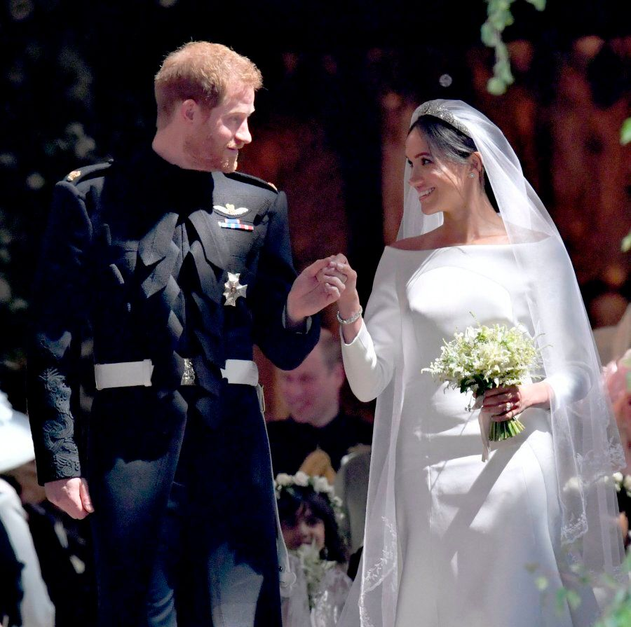 Britain's Prince Harry, Duke of Sussex and his wife Meghan, Duchess of Sussex emerge from the West Door...