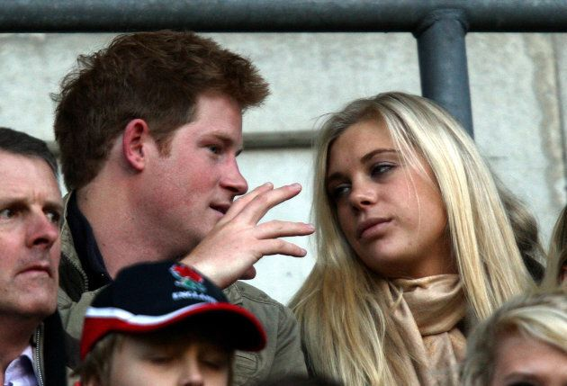 Prince Harry (left) and Chelsy Davy (right) watch from the stands during the Investec Challenge Series...