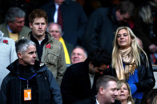 Prince Harry and Chelsy Davy watch from the stands during the Investec Challenge Series match at Twickenham...