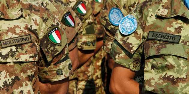 Italian UN peacekeepers stand as honour guards during a visit by Italian Foreign Minister Giulio Terzi...