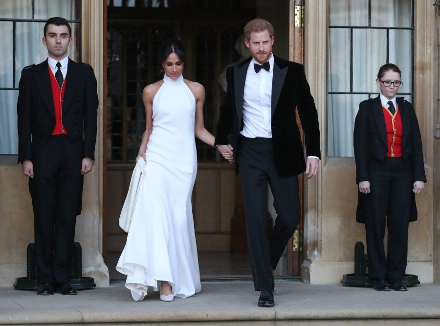 The newly married Britain's Prince Harry, Duke of Sussex, (R) and Meghan Markle, Duchess of Sussex, (L)...