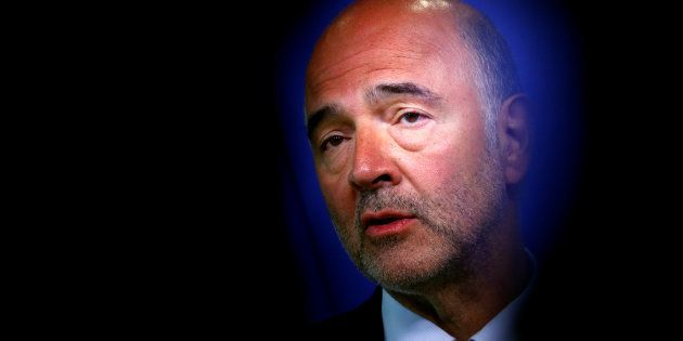 European Economic and Financial Affairs Commissioner Pierre Moscovici speaks during a news conference...